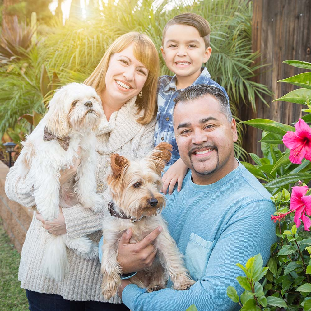 Tropical Mixed Race Family Portrait Outdoor